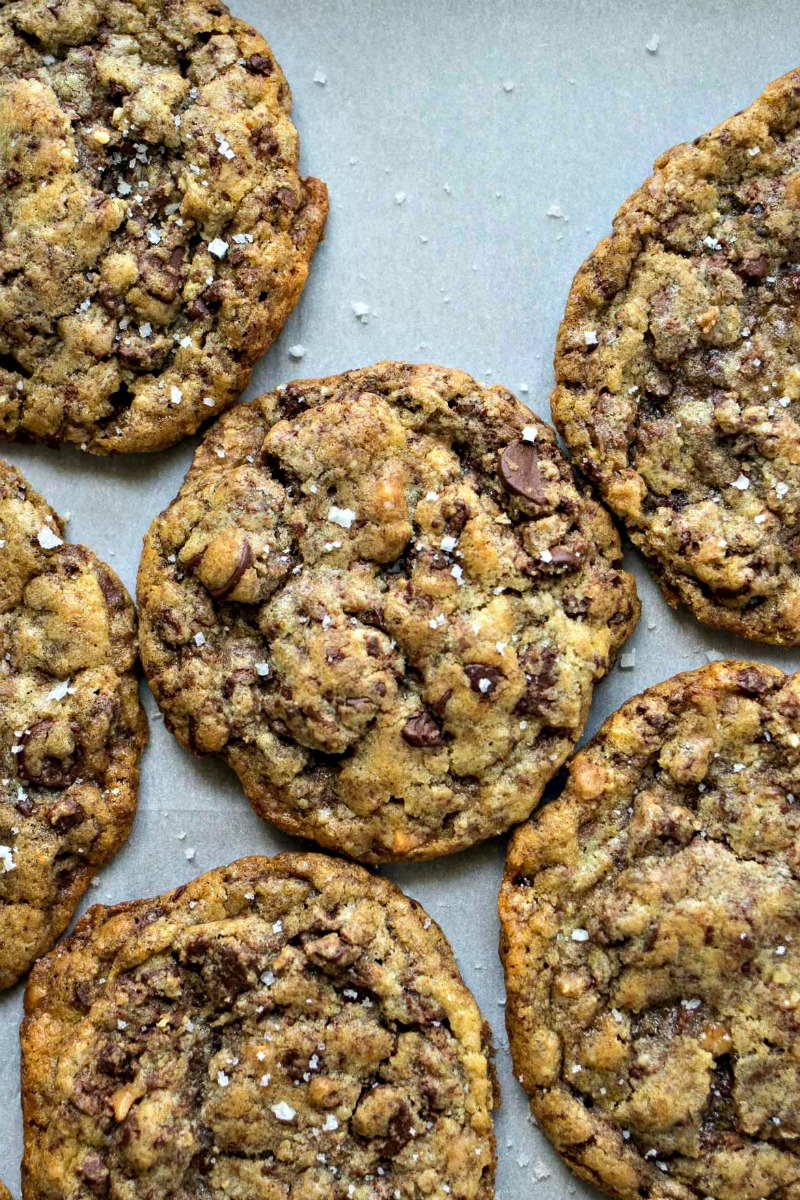 Sea Salt Toffee Chocolate Chip Cookies on a sheet of wax paper