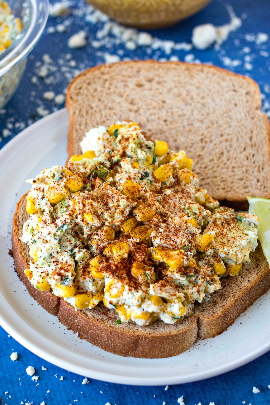 Mexican Street Corn Chicken Salad on bread with spices on top