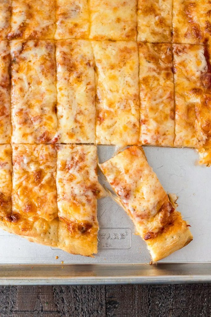 Four Cheese Pizza Dunkers - Homemade pizza layered with mozzarella, asiago, provolone, and parmesan cheese and then cut into Rectangles. They're perfect for dipping in your favorite sauces!