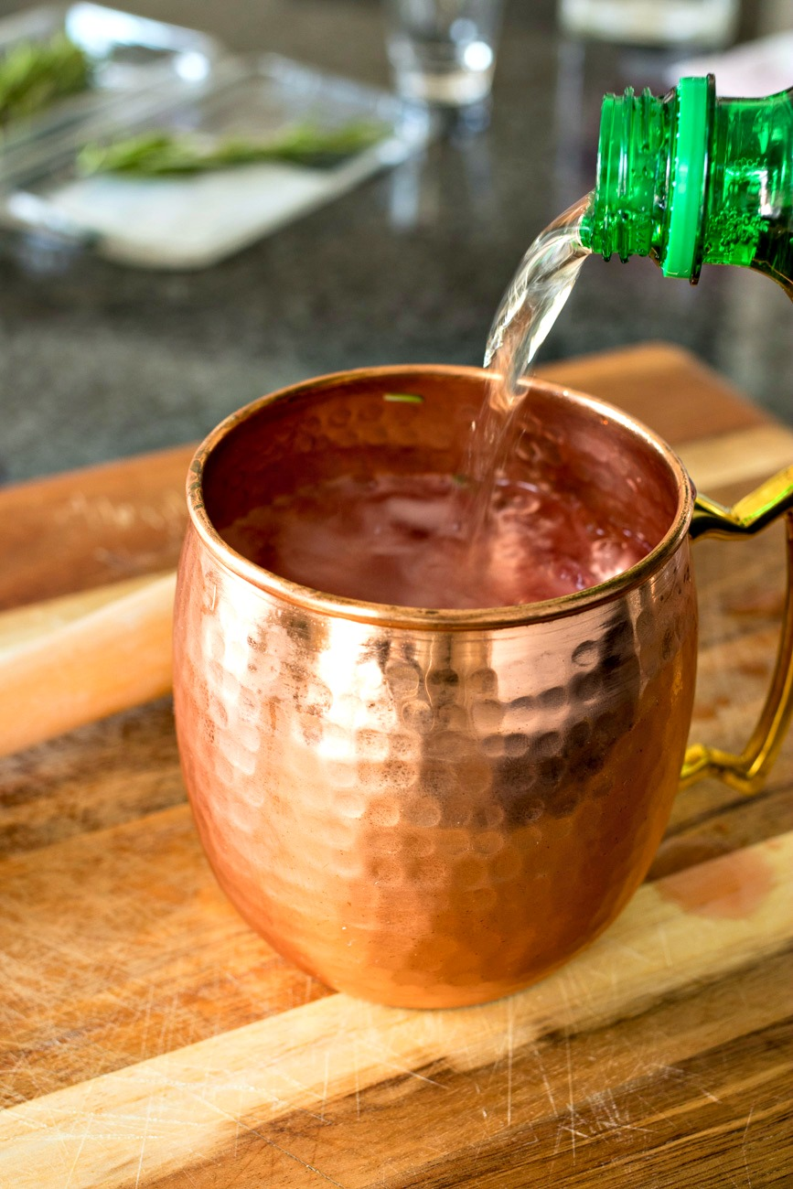 Adding ginger ale to the mug