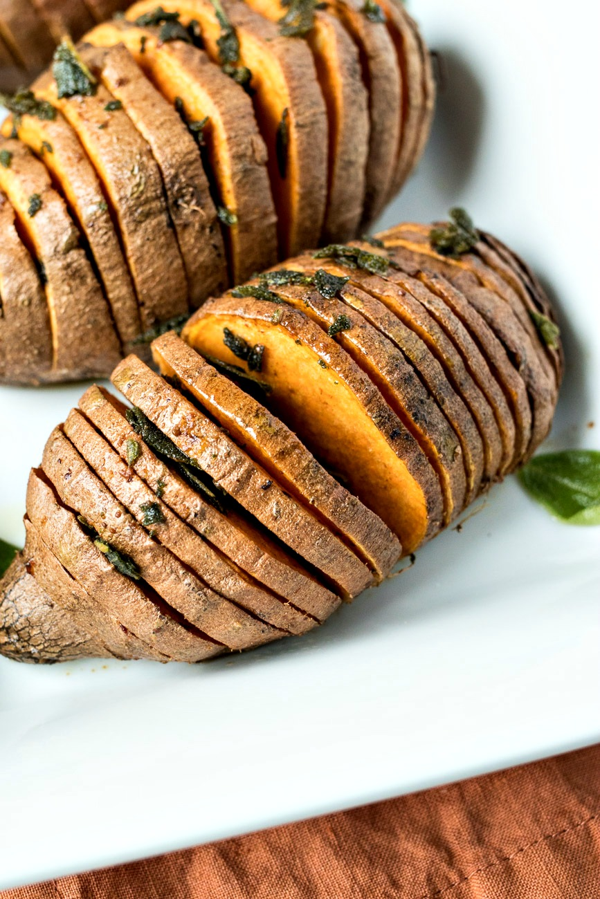 Sage & Browned Butter Hasselback Sweet Potatoes on a plate
