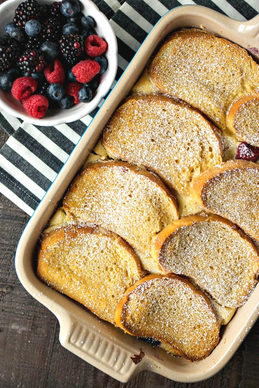 Pan of Berries & Cream Stuffed French Toast Casserole