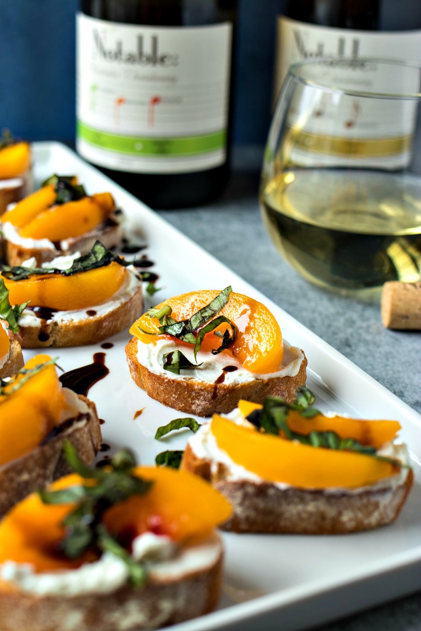 Serving tray of Peach & Goat Cheese Crostini