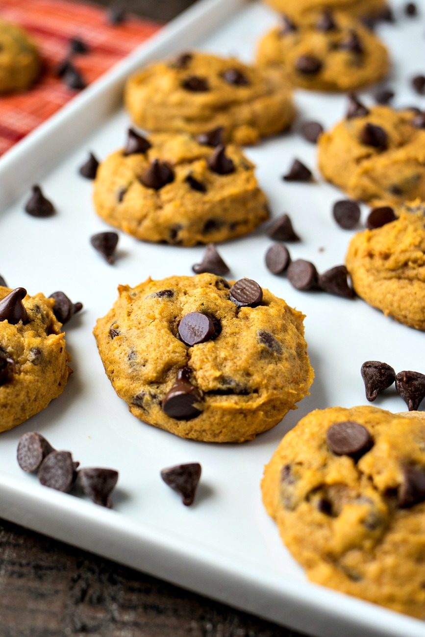 Cookie sheet full of chocolate chips and Pumpkin Chocolate Chip Cookies