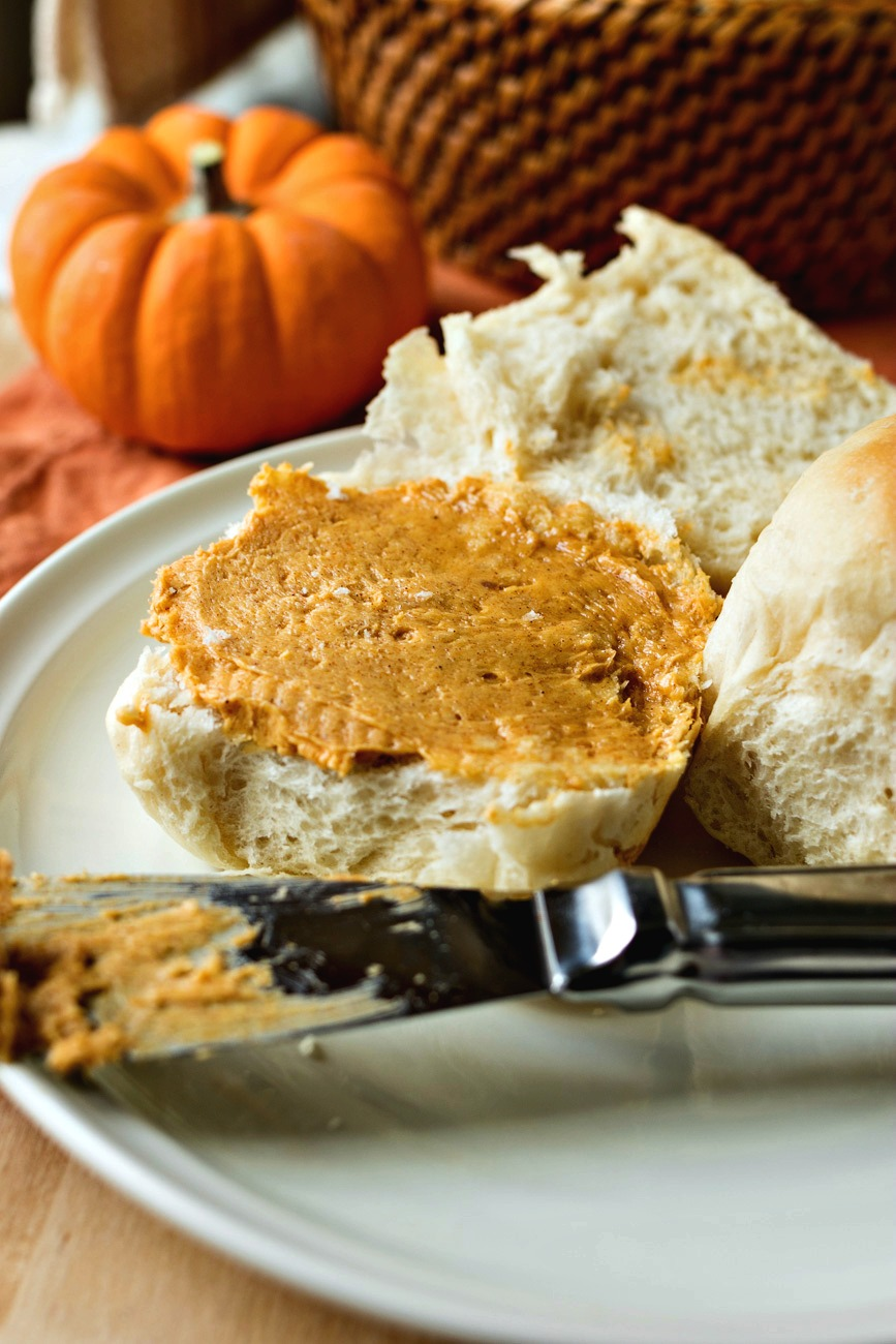 Whipped pumpkin butter spread across a Sweet Yeast Roll that has been cut in half