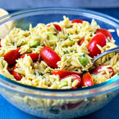 Lemon Avocado Pasta Salad - Orzo pasta is tossed with fresh cherry tomatoes, creamy avocado, basil, olive oil, and fresh lemon juice to make a light, yet satisfying side dish for any meal