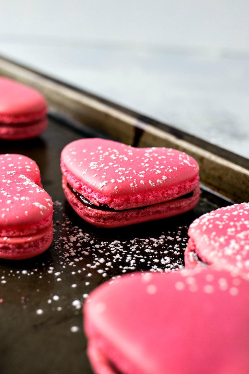 Pink Raspberry Macaron Hearts covered in powdered sugar