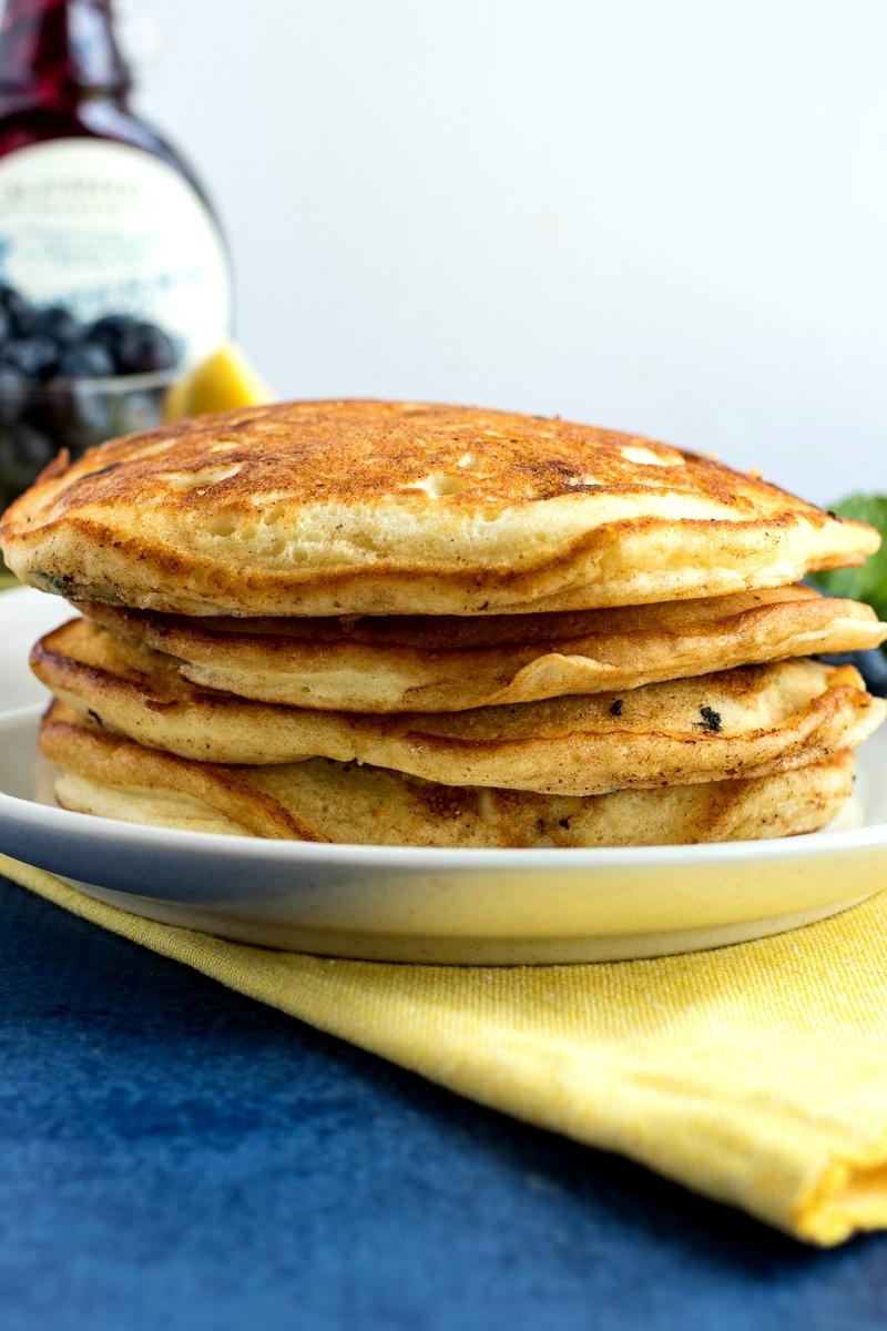 Stack of Lemon Blueberry Ricotta Pancakes before adding syrup