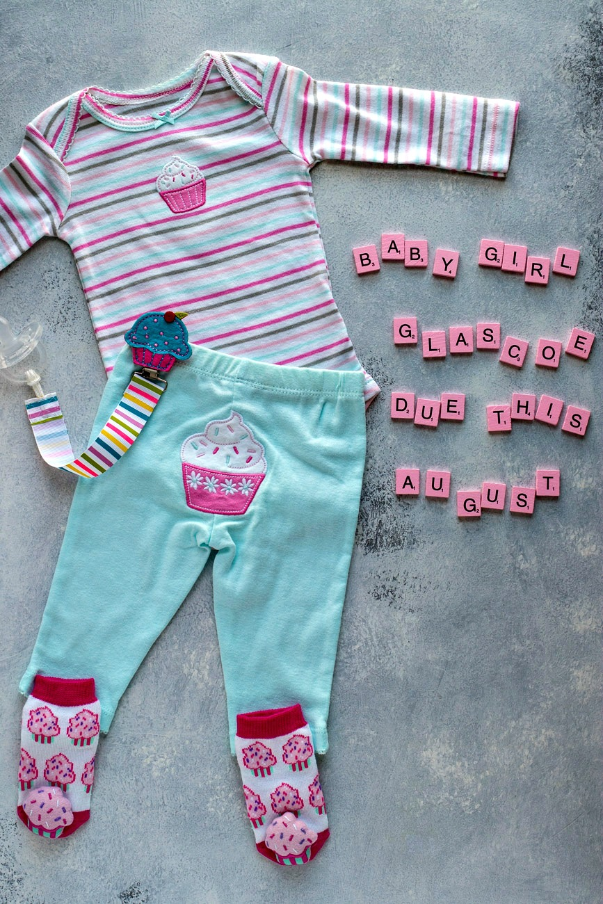 Baby clothes next to blocks spelling out, baby girl glascoe due this august