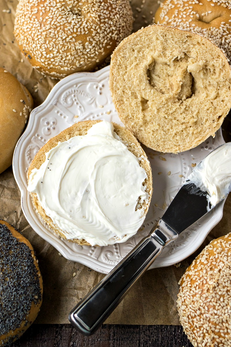 Homemade Bagels spread with cream cheese