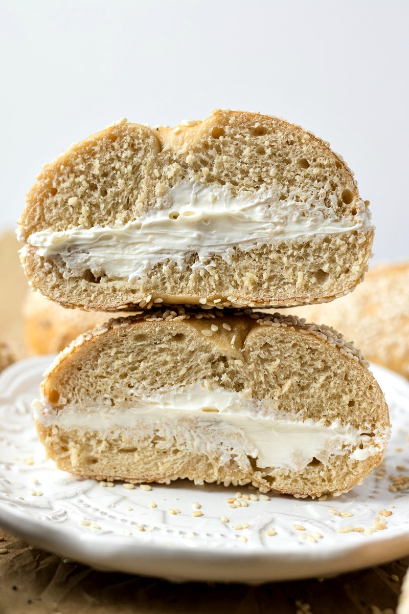 Bagel spread with cream cheese stacked on each other