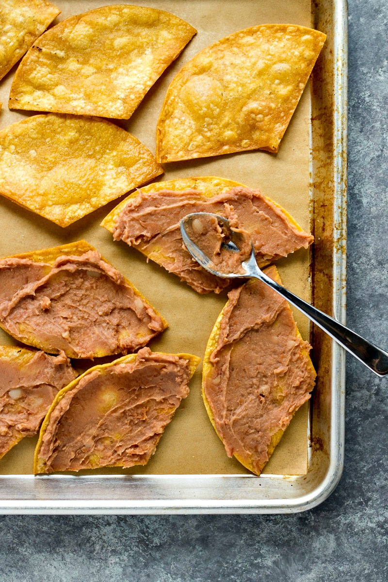Adding refried beans to tortilla chips