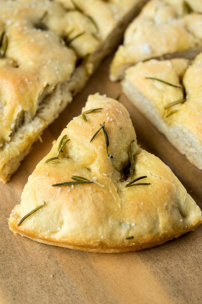 Slice of Rosemary & Olive Oil Foccacia topped with pieces of rosemary