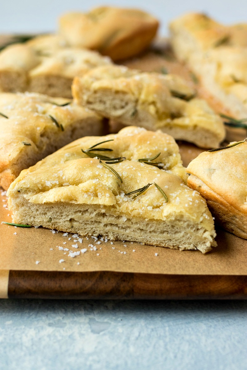 Rosemary & Olive Oil Focaccia Bread slices on brown paper