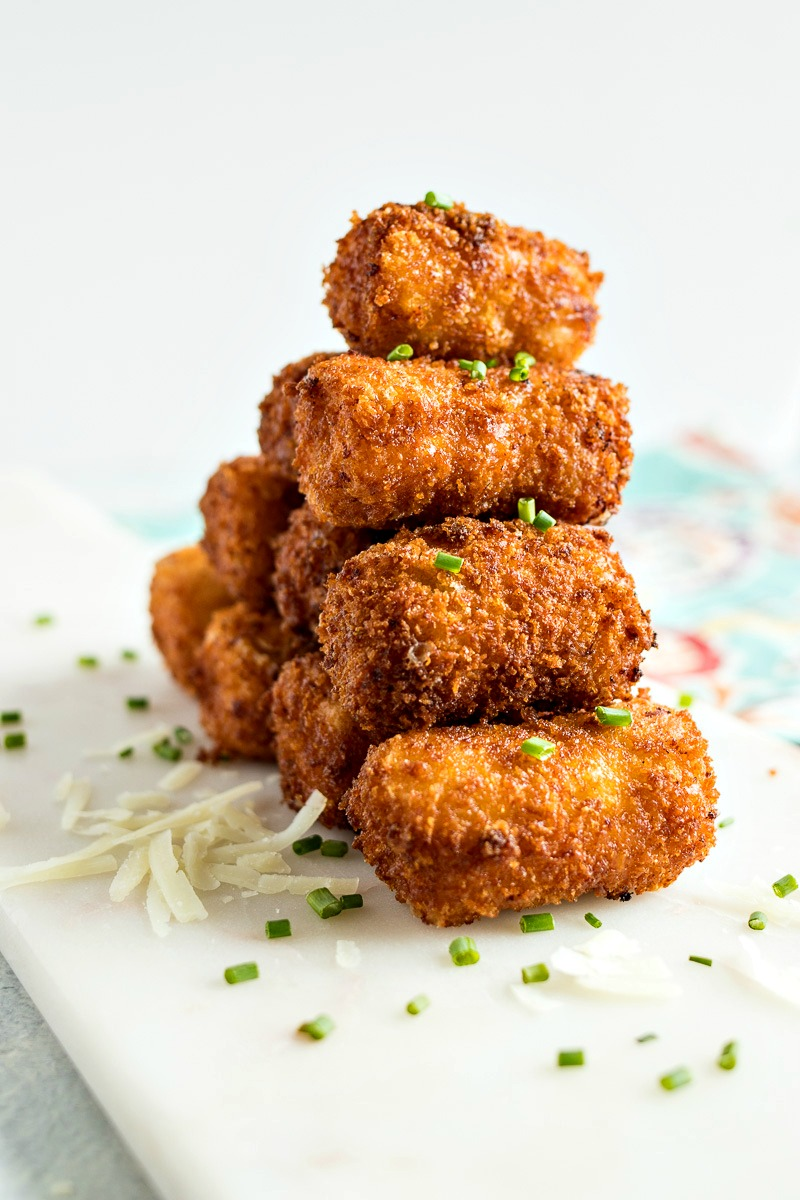 Ham & Cheese Croquettes - Dumplings filled with rich prosciutto ham and manchego cheese are rolled in breadcrumbs and fried to perfection to make for one of the best appetizers you'll ever have