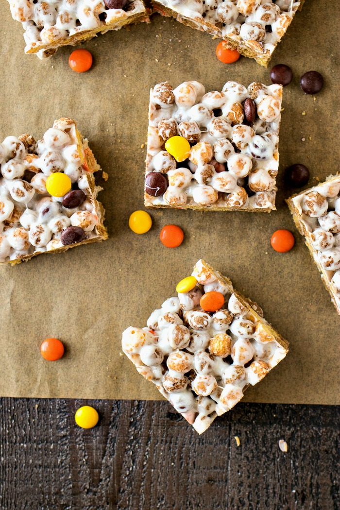 Reese's Crispy Cereal Bars - You're average rice crispy treats are getting a makeover thanks to lots of peanut butter and chocolate. Made only with Reese's Puffs cereal, Reese's Pieces, marshmallows and butter, this will be your new favorite afternoon treat!