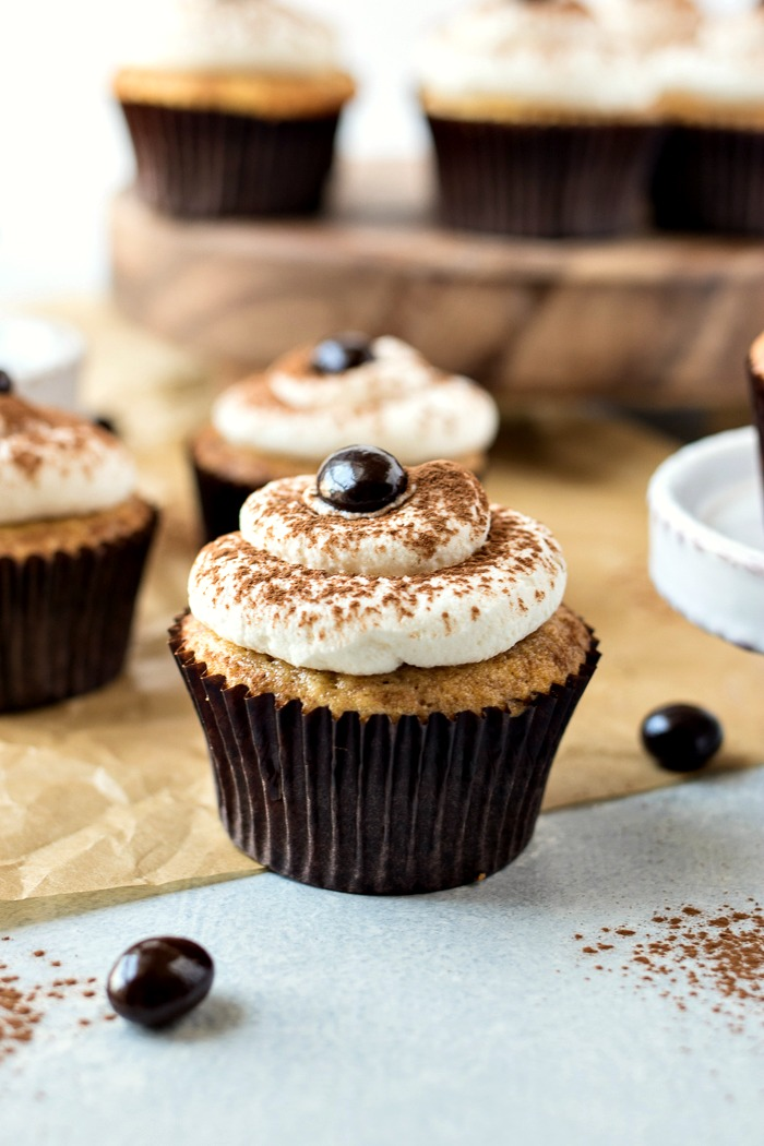 Tiramisu Cupcakes topped with espresso powder and marscapone cream
