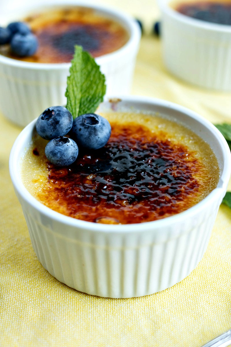 Dish of Blueberry Crème Brûlée topped with whole blueberries