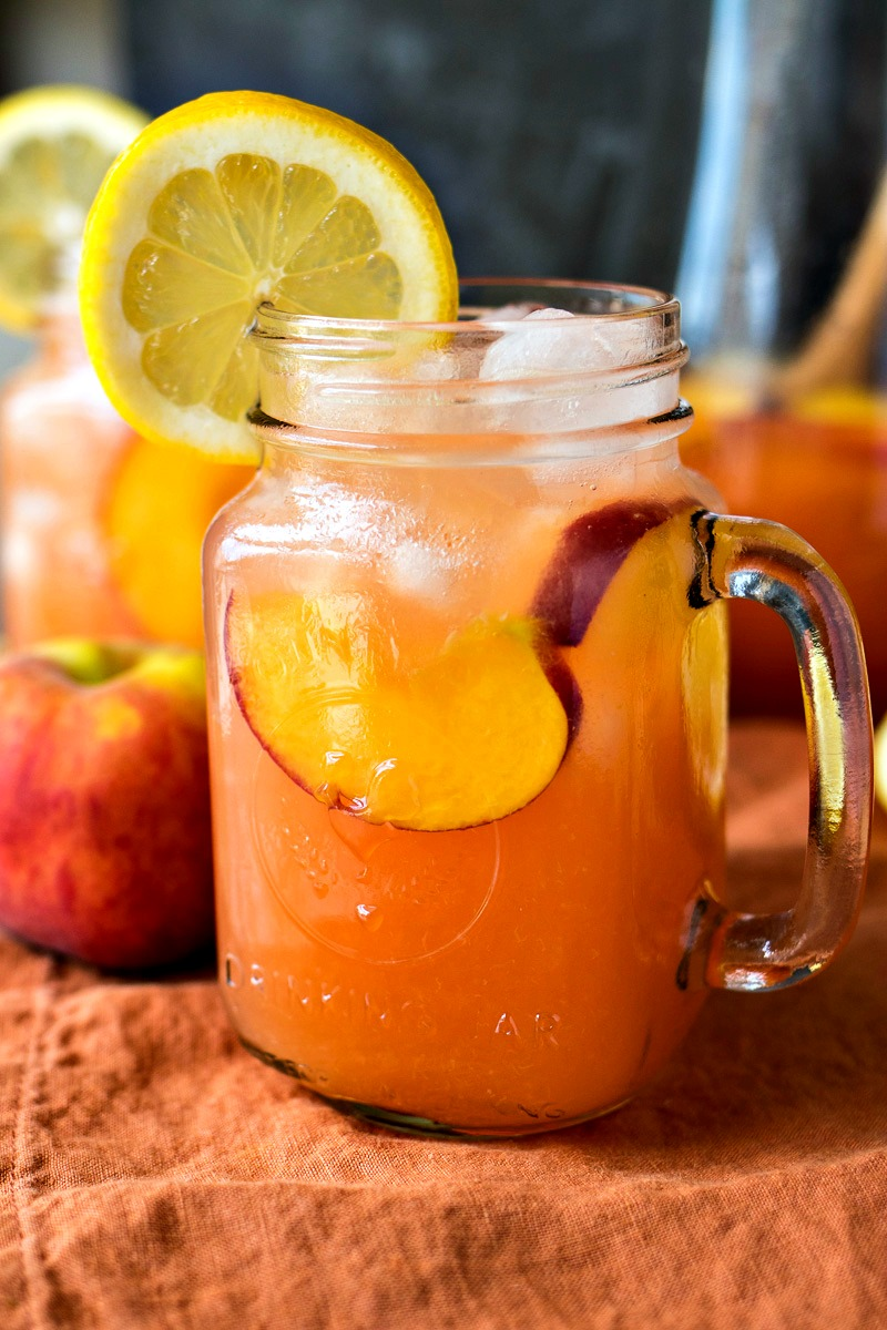 Peach Lemonade - Homemade lemonade is taken to a new level with the addition of fresh peaches. It will be your new favorite summer drink!