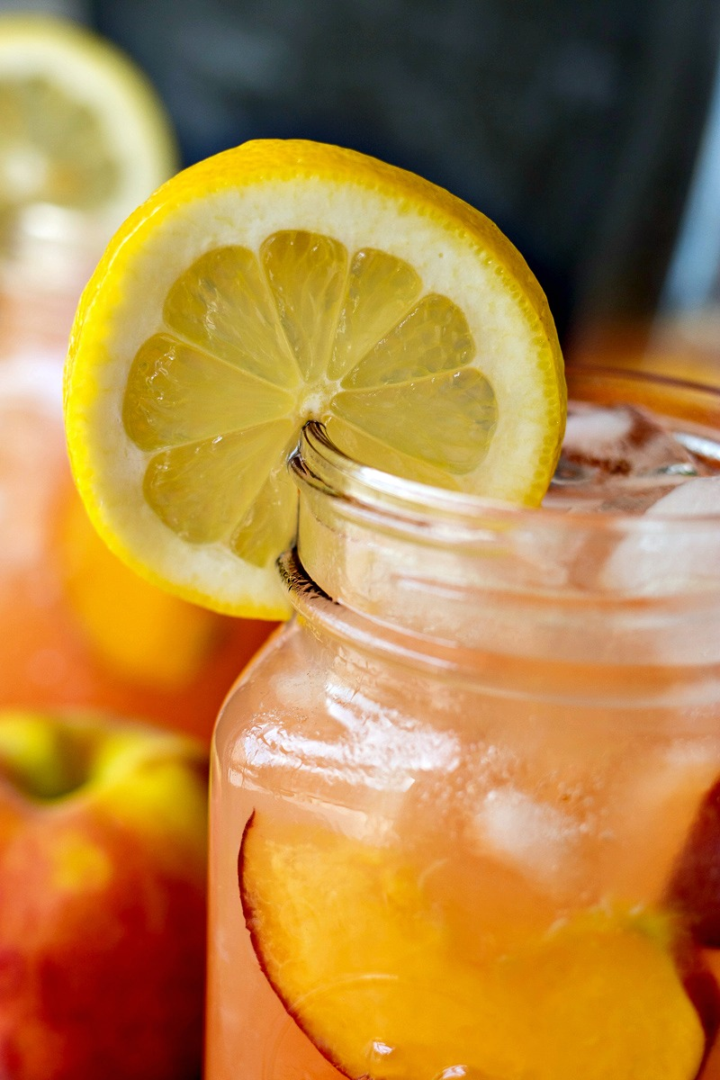 Lemon slice garnished on the rim of Peach Lemonade