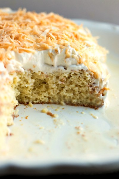 Coconut Tres Leches - Traditional tres leches is given a tropical makeover with the addition of coconut cream and toasted coconut.