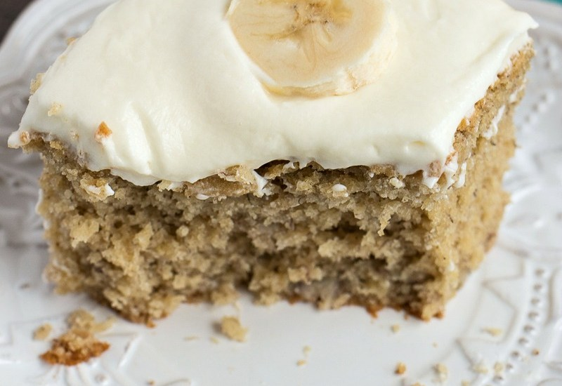 Easy Banana Cake - A moist, dense banana sheet cake topped with homemade cream cheese frosting.