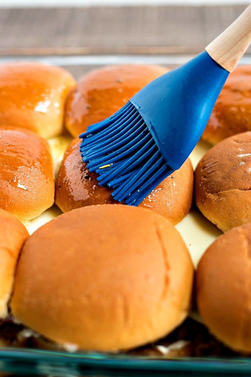 Brushing slider buns with melted butter