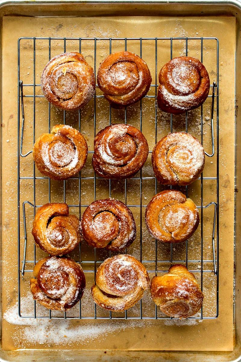 Vanilla Bean Morning Buns with vanilla bean sugar on a coolling rack