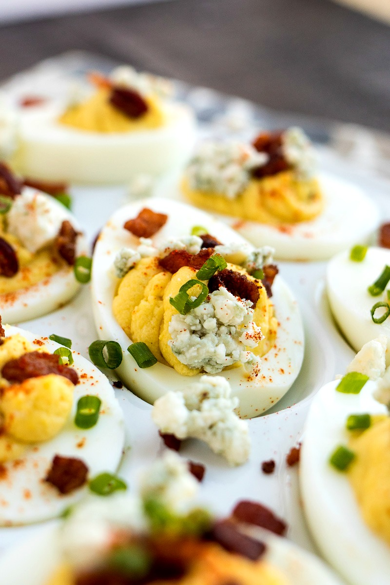 Bacon & Blue Cheese Deviled Egg topped with bacon, scallions and blue cheese