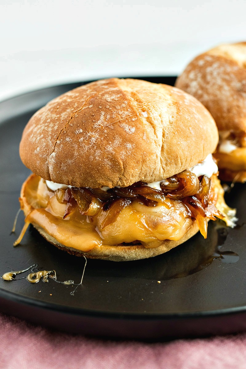 Pork Gouda Burgers on a black plate