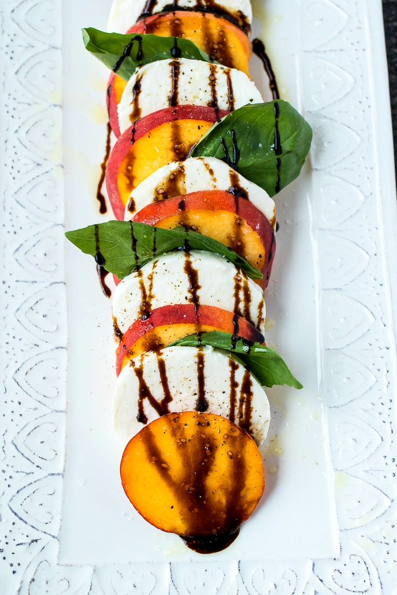 Serving tray of Peach Caprese Salad