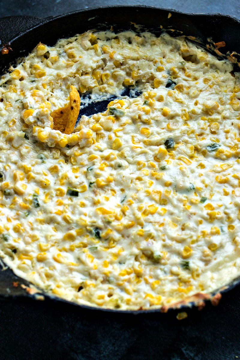 Corn chip scooping through the Creamy Skillet Corn Dip