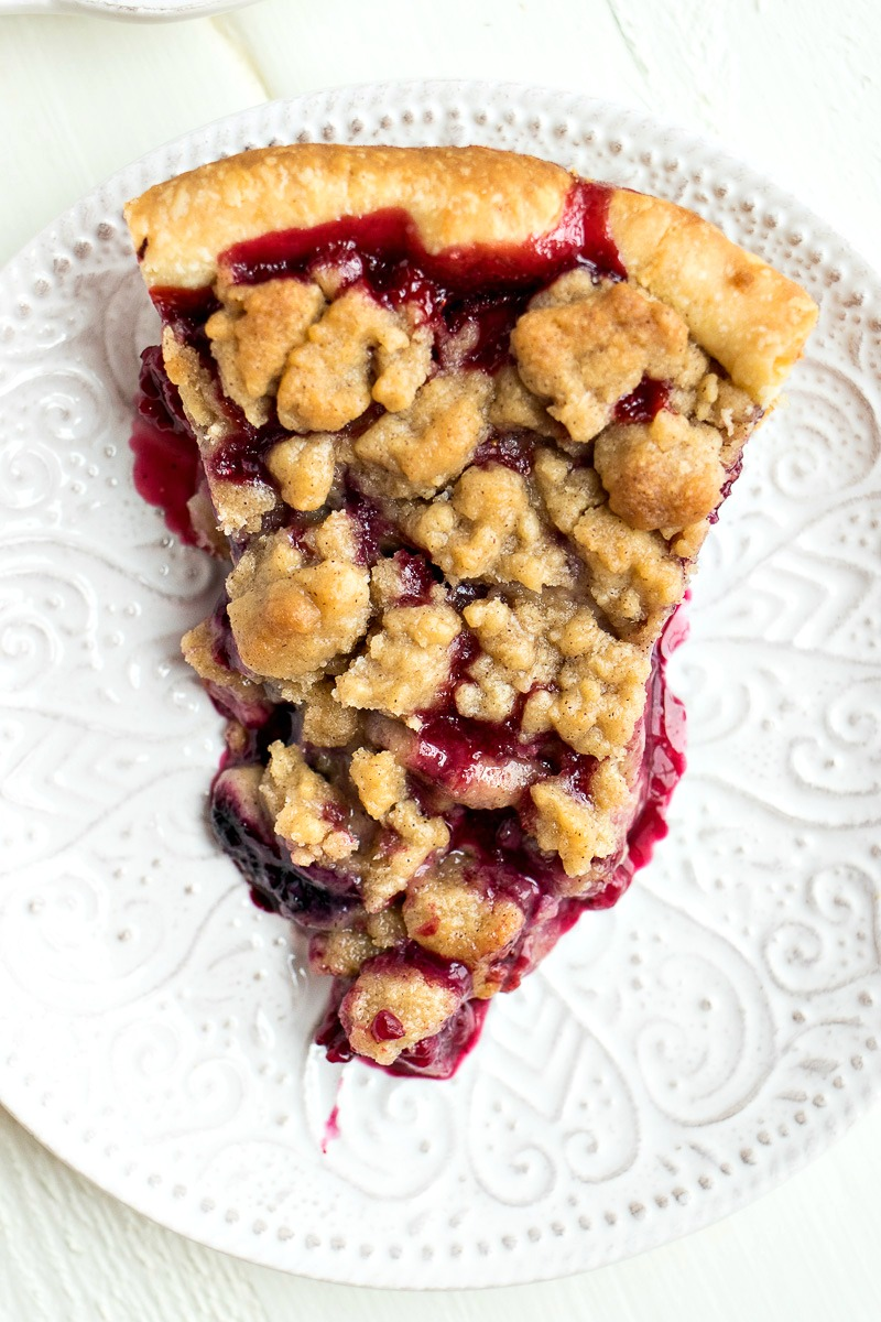 Slice of Berry Crumble Pie on a plate