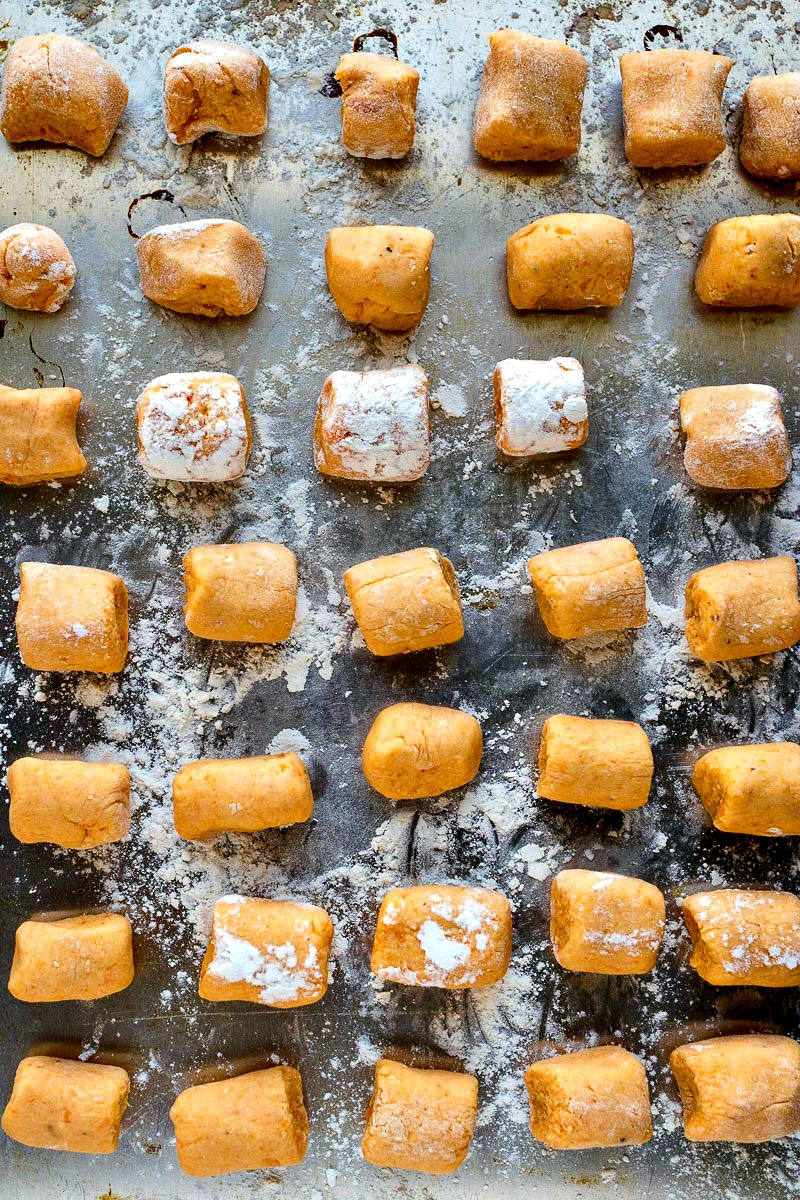Cookie sheet of uncooked sweet potato gnocchi