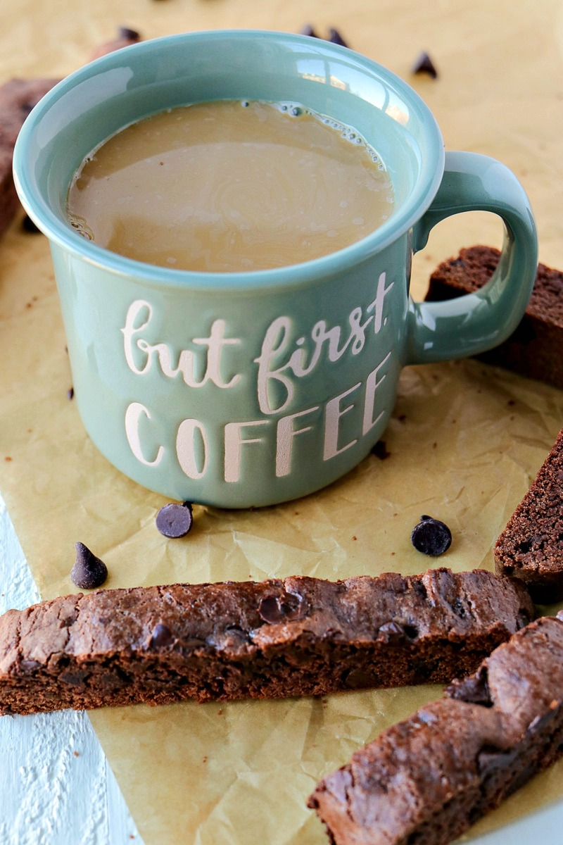 Cup of coffee next to slices of Double Chocolate Biscotti