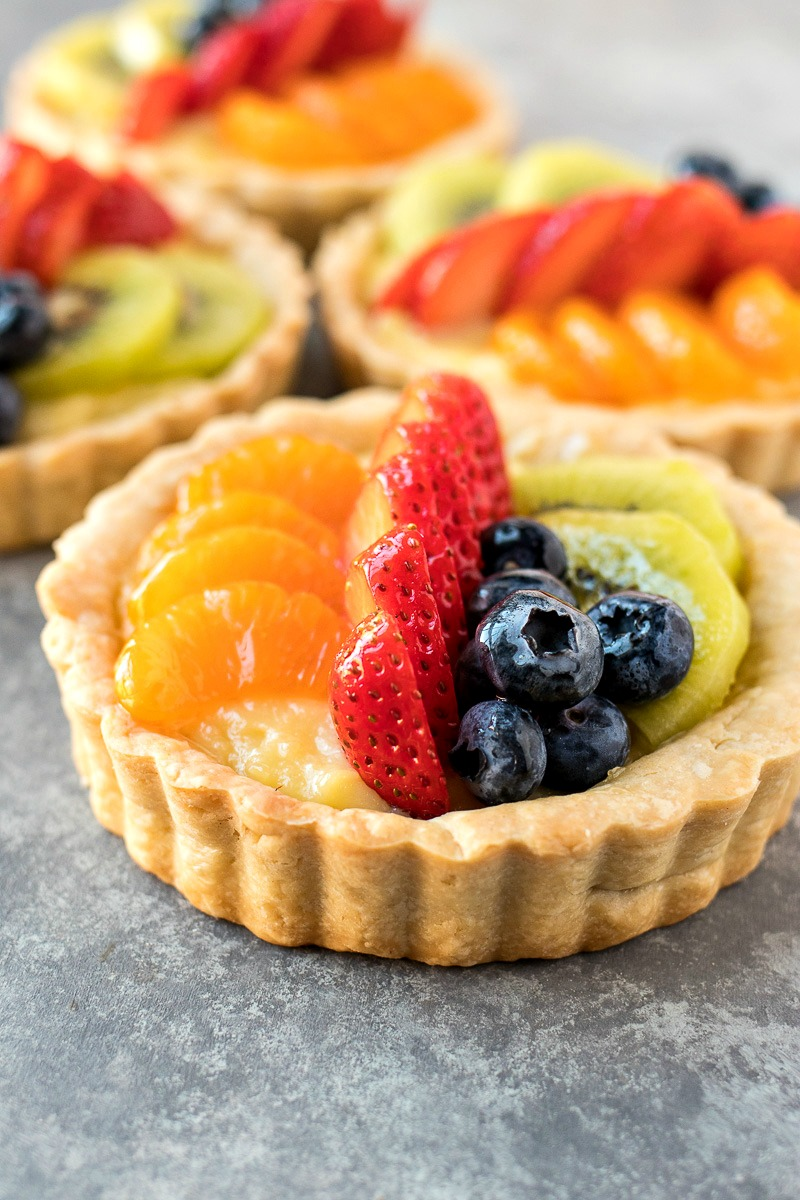 Rich vanilla pastry cream is filled into a buttery mini tart shell and covered with fresh fruit