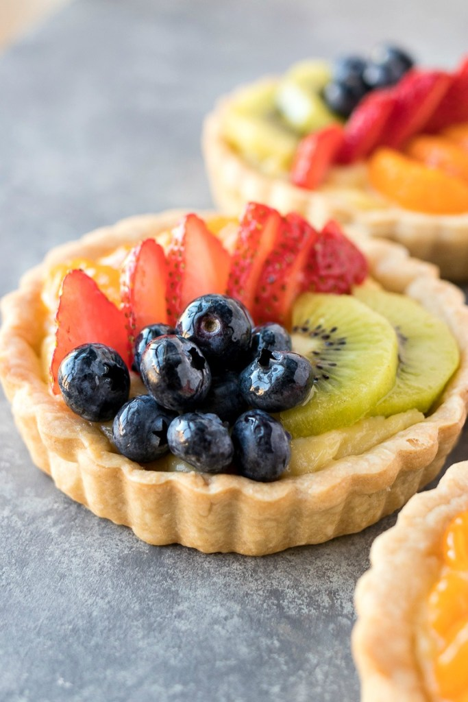 zoomed in shot of min fruit tarts, shot from a side angle