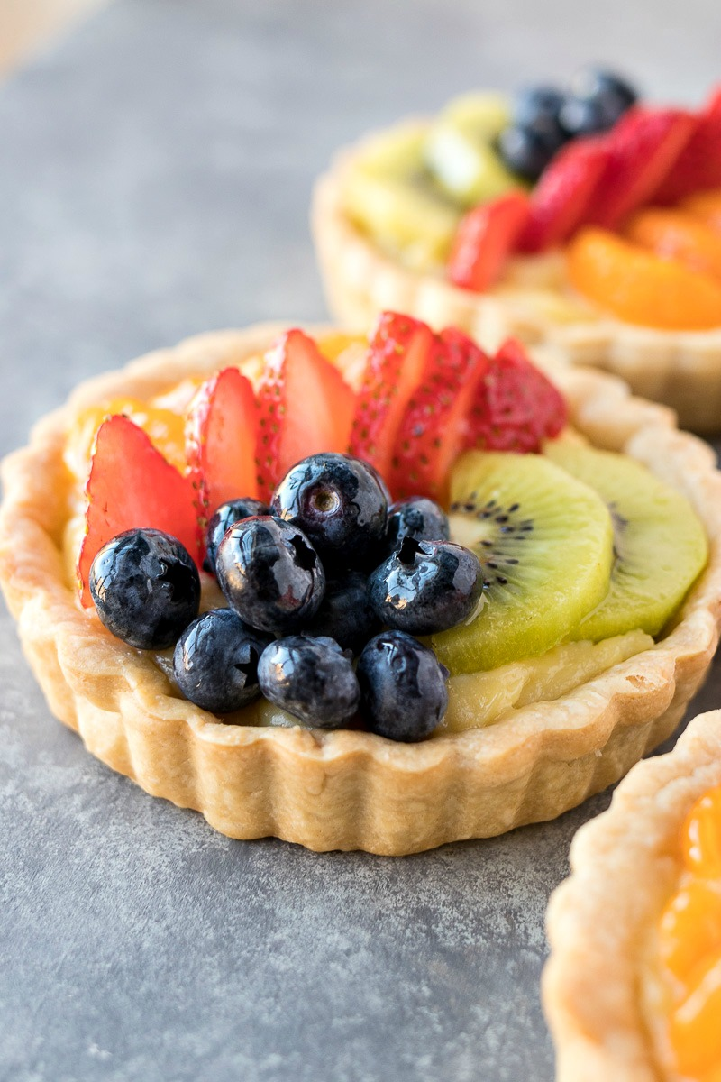 Pastry filled with strawberries, blueberries and kiwis on top of cream