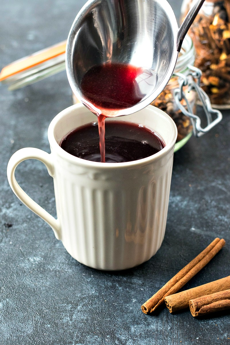 Using a ladle to pour Slow Cooker Mulled Wine into a cup