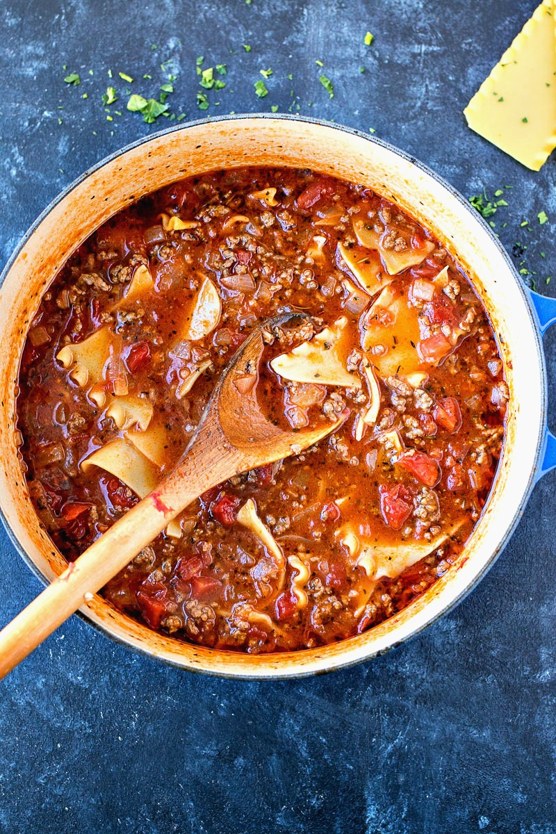 Large pot of Lasagna Soup with a wooden spoon