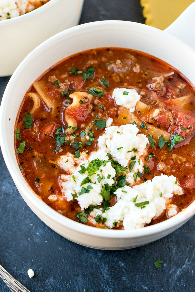 Closeup on a bowl of Lasagna Soup with ricotta cheese on top