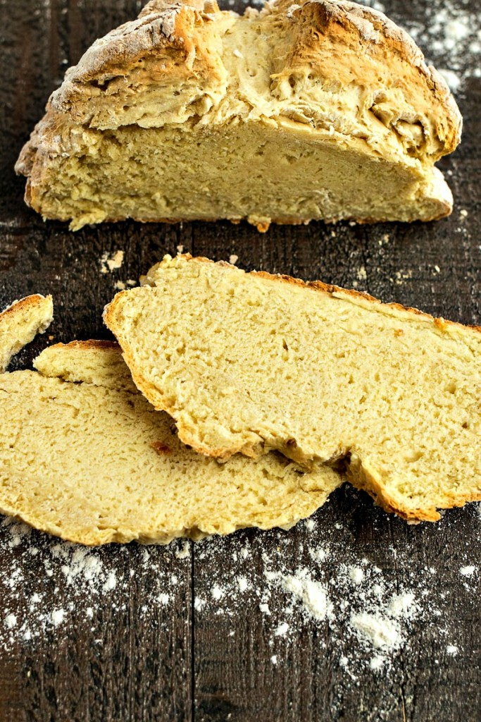 Slices of irish soda bread in front of the loaf