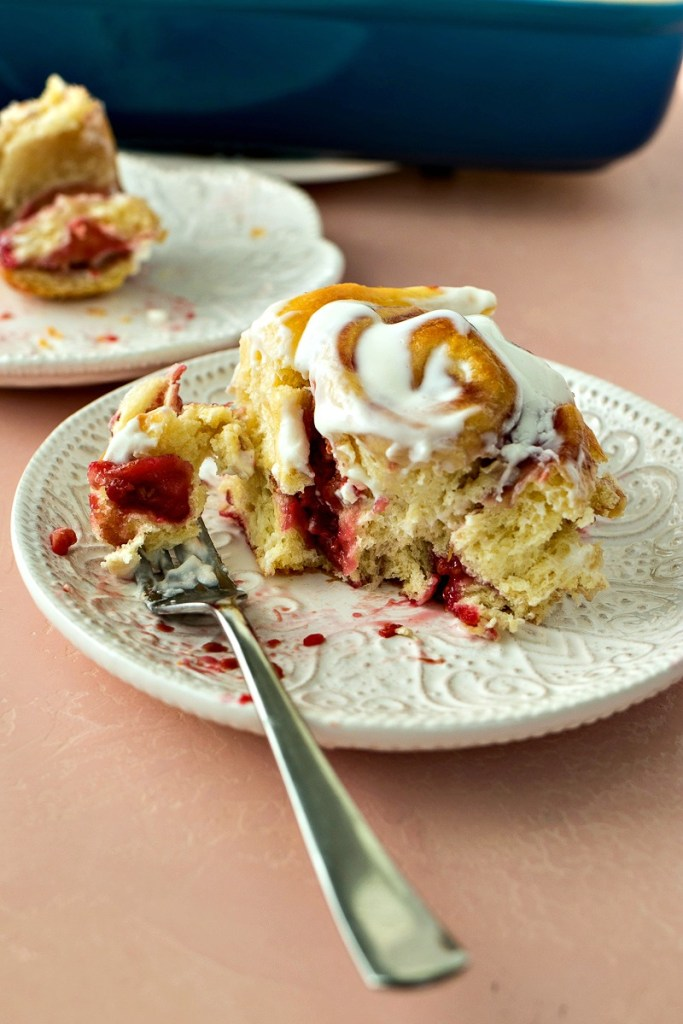 Sweet yeast dough filled with raspberry jam and fresh raspberries topped with a tangy icing