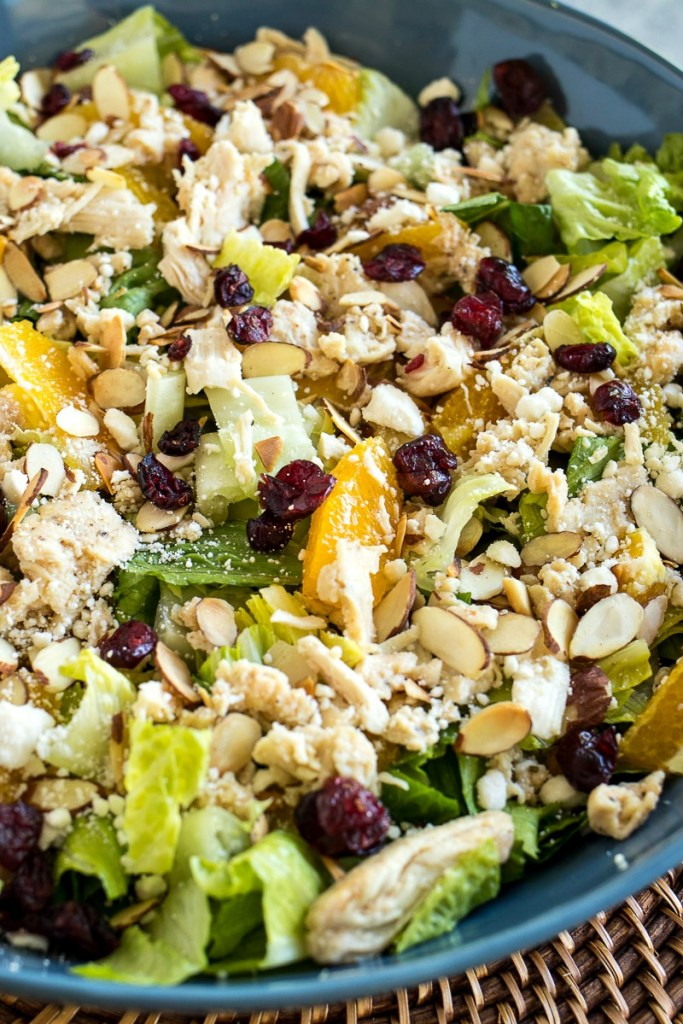 Romaine lettuce tossed with fresh orange segments, sliced almonds, feta cheese, diced chicken, dried cranberries, and a homemade citrus vinaigrette.