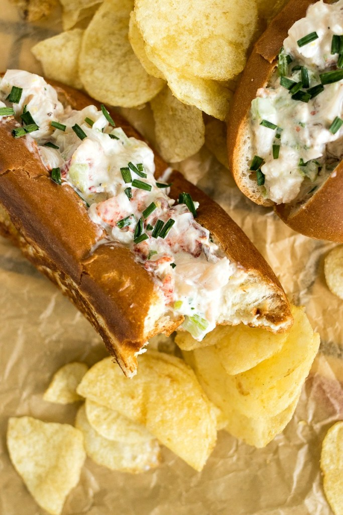 Closeup on lobster roll with a bite out of it