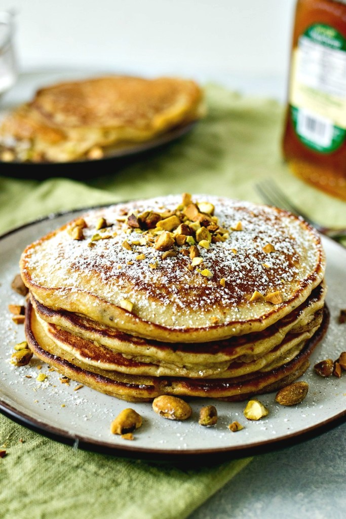 Stack of Pistachio Pancakes topped with crushed pistachios