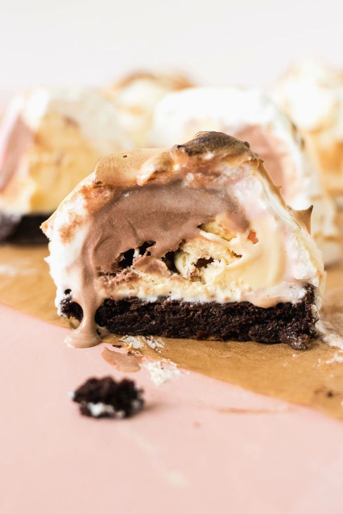 Mini Baked Alaska cut in half to show the melted ice cream and brownie inside
