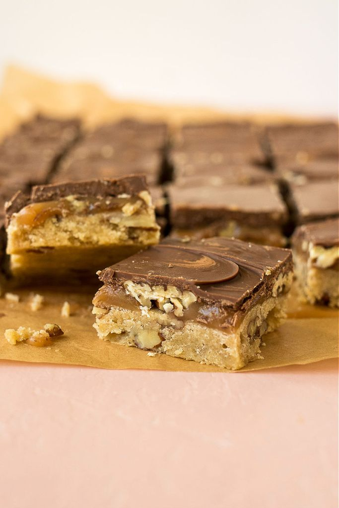 zoomed in shot of cut chocolate pecan turtle bar at an angle