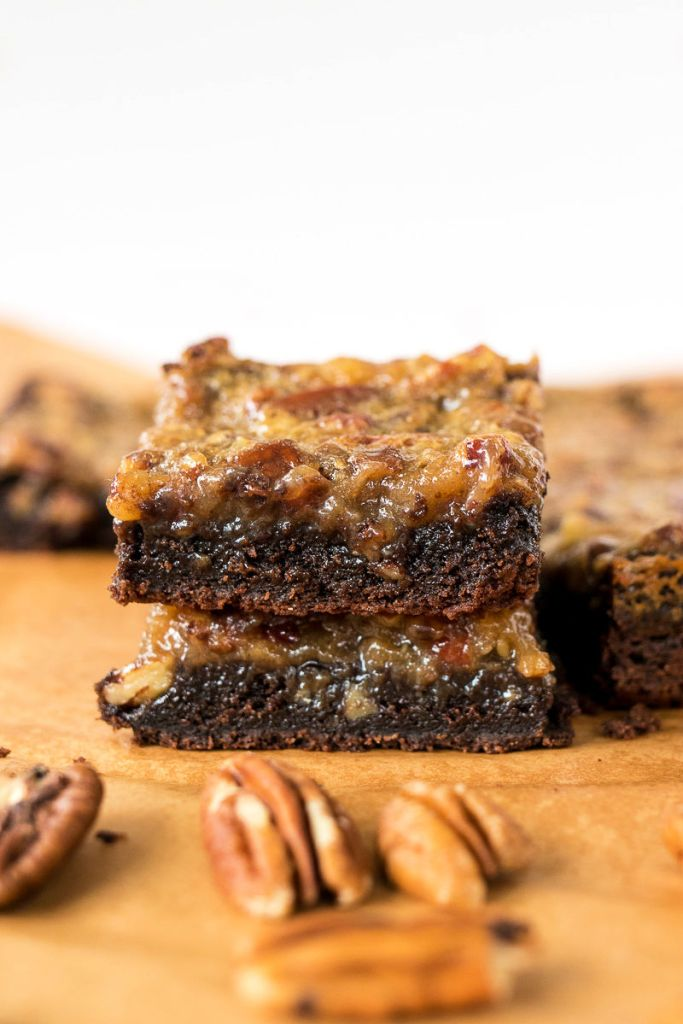 photos of stacked pecan pie brownies with a few pecans in the foreground