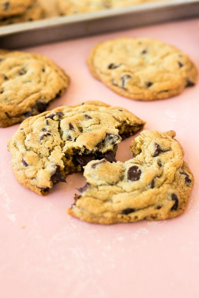 chocolate chip broken in half so you can see the gooey chocolate center